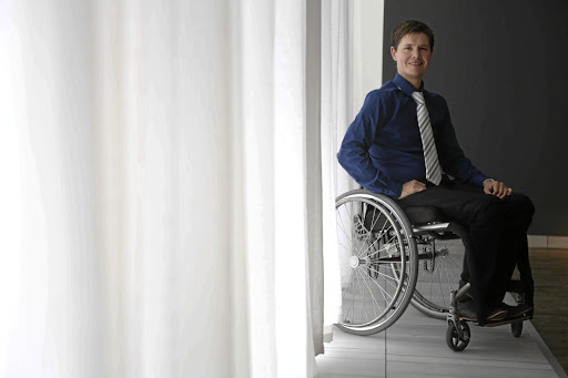 Andrew Merryweather, who was left paralysed after an assault nearly a decade ago, is studying to become  a certified financial planner. Picture: Esa Alexander