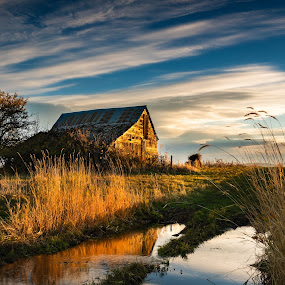 Old Barn Sunrise by Evan Jones - Buildings & Architecture Decaying & Abandoned ( countryside, old, wood, shack, door, farmland, glow, americana, sky, nature, barn, awesome, summertime, ranch, orange, structure, grass, agriculture, fashioned, dusk, rural, country, rural landscape, roof, dawn, serene, hay, outdoors, scene, natural, small, golden, calm, green field, reflection, america, rocky, land, valley, beauty, landscape, spring, usa, sun, farm, idaho, tranquil, mountains, rust, evening, clouds, water, building, united, peaceful, vintage, camas, scenic, morning, prairie, farming, amazing, broken, field, shed, small town, wooden, blue, views, sunset, americana background, brown, sunrise, scenery, down )