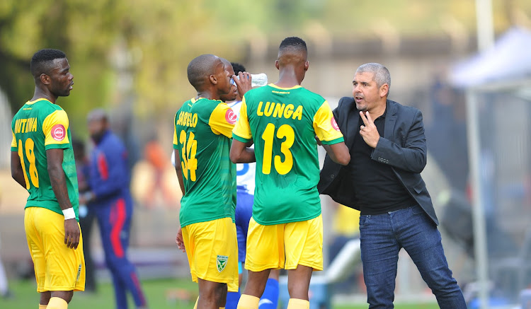 Lamontville Golden Arrows head coach Clinton Larsen dishes out instructions to his players during their Absa Premiership match against provincial rivals Maritzburg United on August 5 2018 at Harry Gwala Stadium.