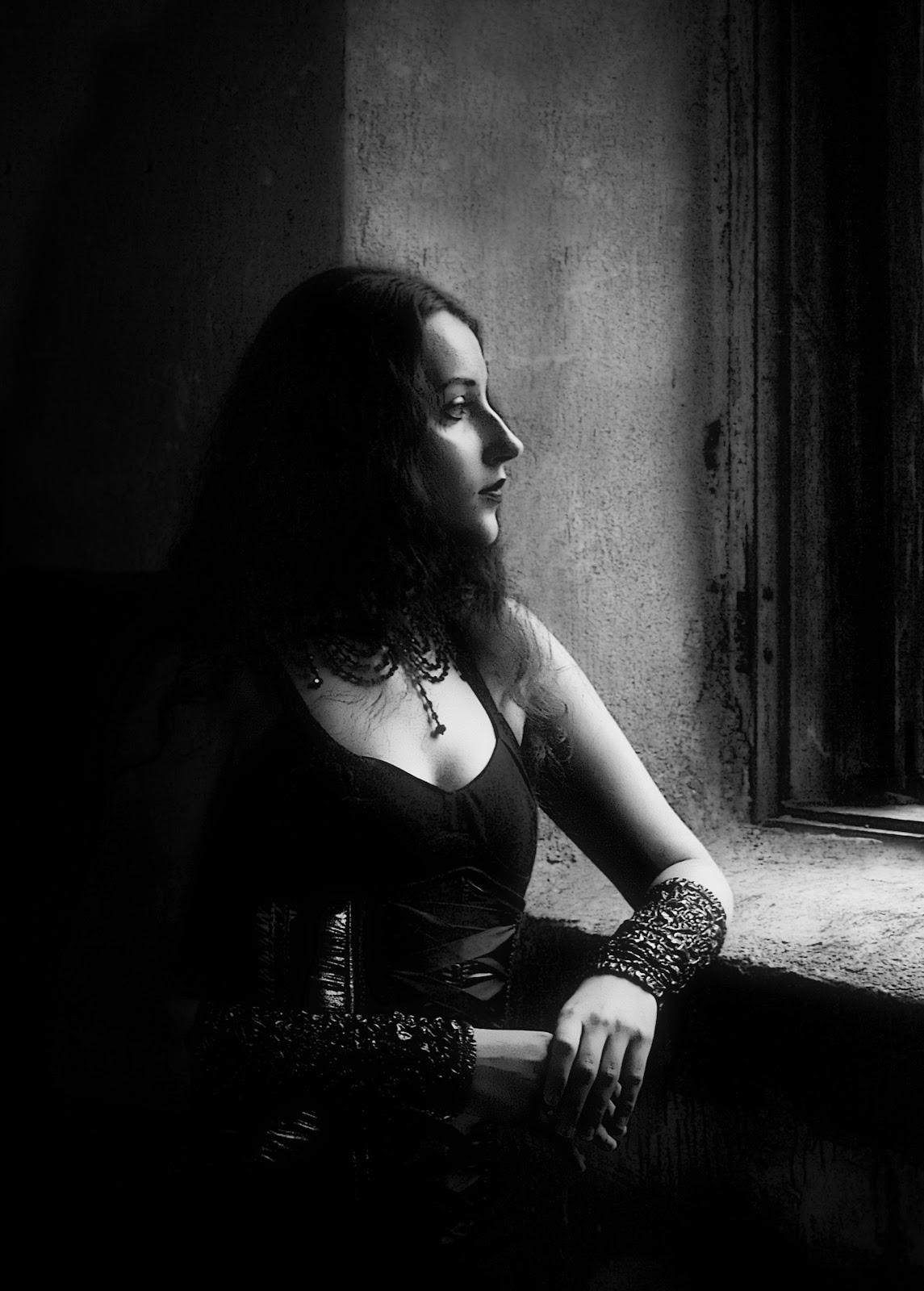 https://get.pxhere.com/photo/light-black-and-white-girl-white-photography-window-profile-portrait-model-sitting-darkness-black-monochrome-lady-gothic-photograph-beauty-costume-emotion-photo-shoot-portrait-of-a-girl-riddle-monochrome-photography-portrait-photography-film-noir-human-positions-833054.jpg