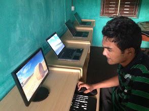 Photo: Shrijan setting up the computers