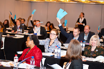 Photo: Members voting at the 2012 Equinet Annual General Meeting