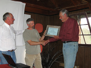 Photo: Camp - Doug Smith receives Outstanding Service Award from Dave Hanna and Patrick Plantenberg