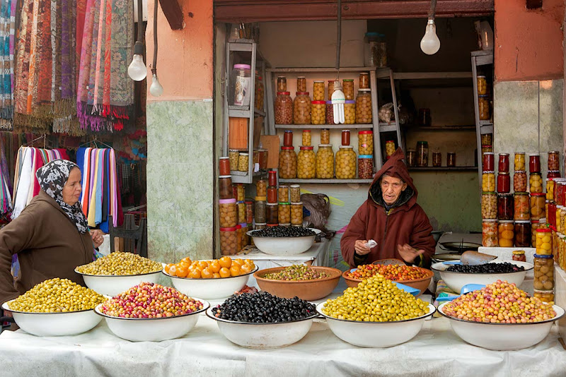 Olives seller from the famous Marrakesh bazaar.