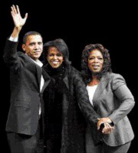 HOPEFUL: Barack Obama, his wife Michelle and Oprah Winfrey. Pic. Brian Snyder. 09/12/07. © Reuters.