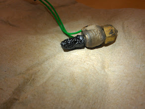 Photo: Got hot enough to _crack_ and discolor the _ceramic_ around the nichrome.
