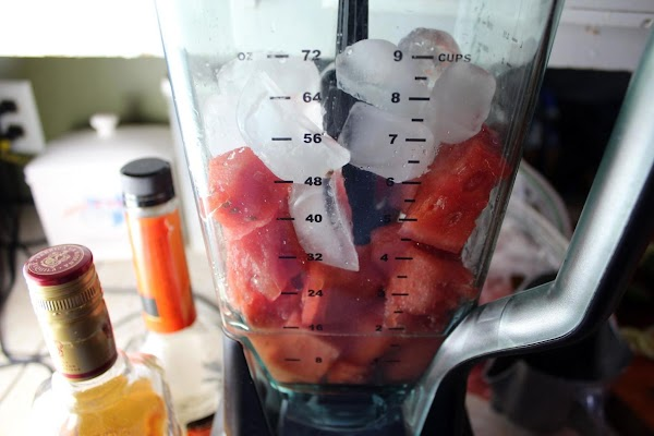 Watermelon, liquors, and ice in a blender.