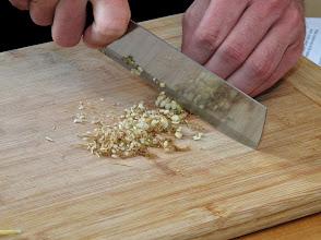 Photo: chopping cilantro roots to make marinade for lemon grass pork