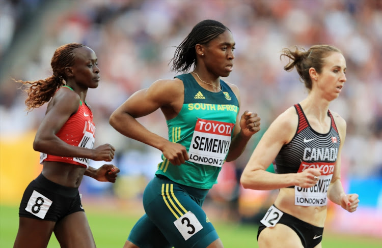 (L-R) Winny Chebet of Kenya, Caster Semenya of South Africa and Nicole Sifuentes of Canada competes in the Women's 1500 metres heats during day one of the 16th IAAF World Athletics Championships London 2017 at The London Stadium on August 4, 2017 in London, United Kingdom.