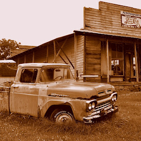 by Emily Vickers - Transportation Automobiles ( automobiles, sepia, old, side of the road, yard, store, grass, tennessee, georgia, general store, transportation, south carolina, junk, north carolina, trucks, mountains, southern, cars, south, rust, antique )