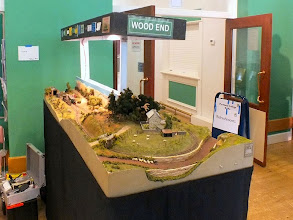 "Photo: 020 Wood End is a U shaped terminus to terminus layout that does not have a fiddle yard. I believe it was one of the first layouts to be built to this now quite frequently seen design. The major plus point of this type of layout is that it provides an actual ""journey"" for the trains to travel, and a good length of run in a spacious uncrowded setting but still in a compact size of layout ."