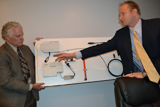 Photo: Roger Timmerman explaining the components used to provide service.