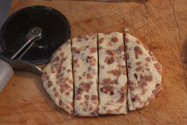 Take each cinnamon roll and cut into 4 long pieces, flatten each piece with...