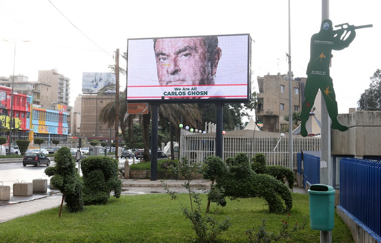A billboard shows solidarity with Carlos Ghosn on a highway in Beirut, Lebanon, on December 4 2018. Picture: REUTERS/MOHAMED AZAKIR