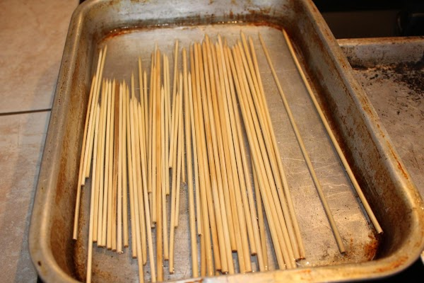 When the vegetables and meat have marinated (24 hours is best), soak wooden skewers...