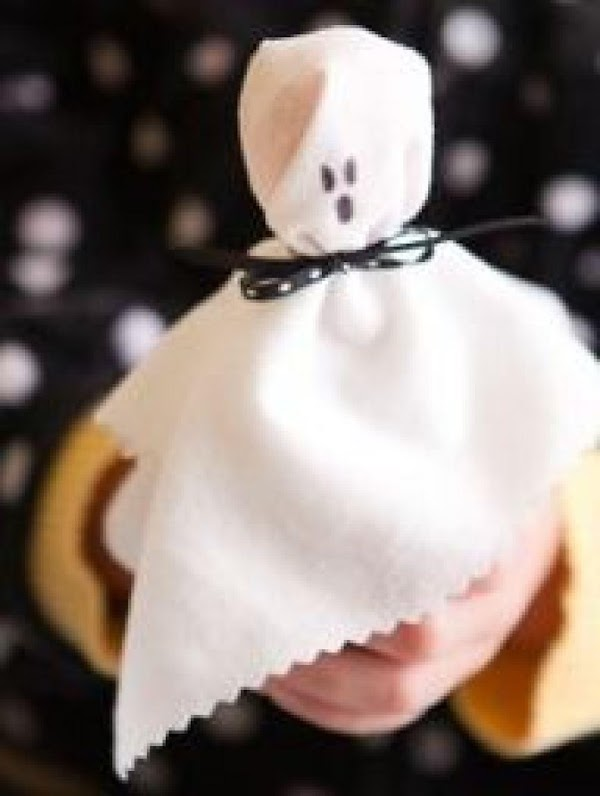 Ghost pops  a 6x6 square of white material, some black yarn or thin ribbon, a...