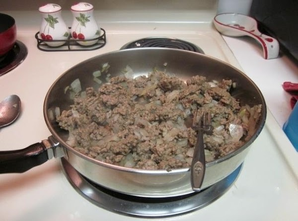 In large skillet, over medium heat, cook ground beef and onions until meat is...