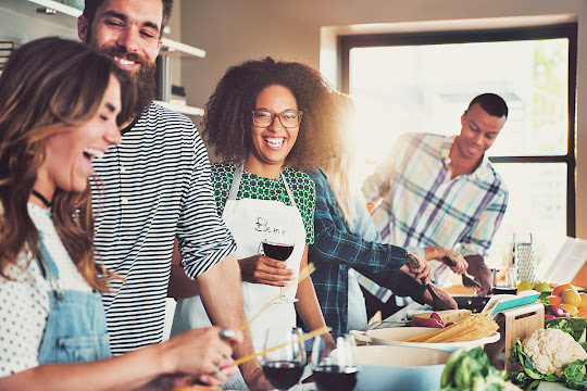 Young Diverse Friends Cooking Dinner and Laughing Together