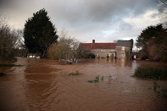 Photo: TAUNTON, ENGLAND - NOVEMBER 21:  Flood waters surrounding a cottage close to the village of North Curry on November 21, 2012 near Taunton, England. Heavy rain overnight has brought widespread disruption to many parts of the UK particularly in the Somerset and Wiltshire and weather forecasters have warned of more wet and windy weather to come.  (Photo by Matt Cardy/Getty Images)