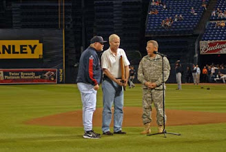 Photo: Maj. Gen. Larry Shellito speaks to the crowd about the flag being presented.