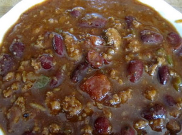 Combine ground beef, cooked celery and onions into large roasters with the tomato juice,...