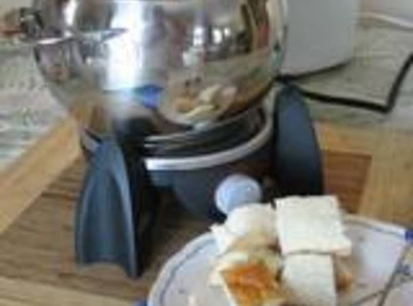 Dip from the fondue pot or individual bowls.Cubes of toasted French bread or Garlic...