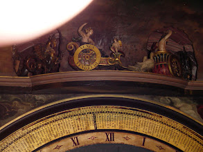 Photo: A detail of some of the figures above the clock face.