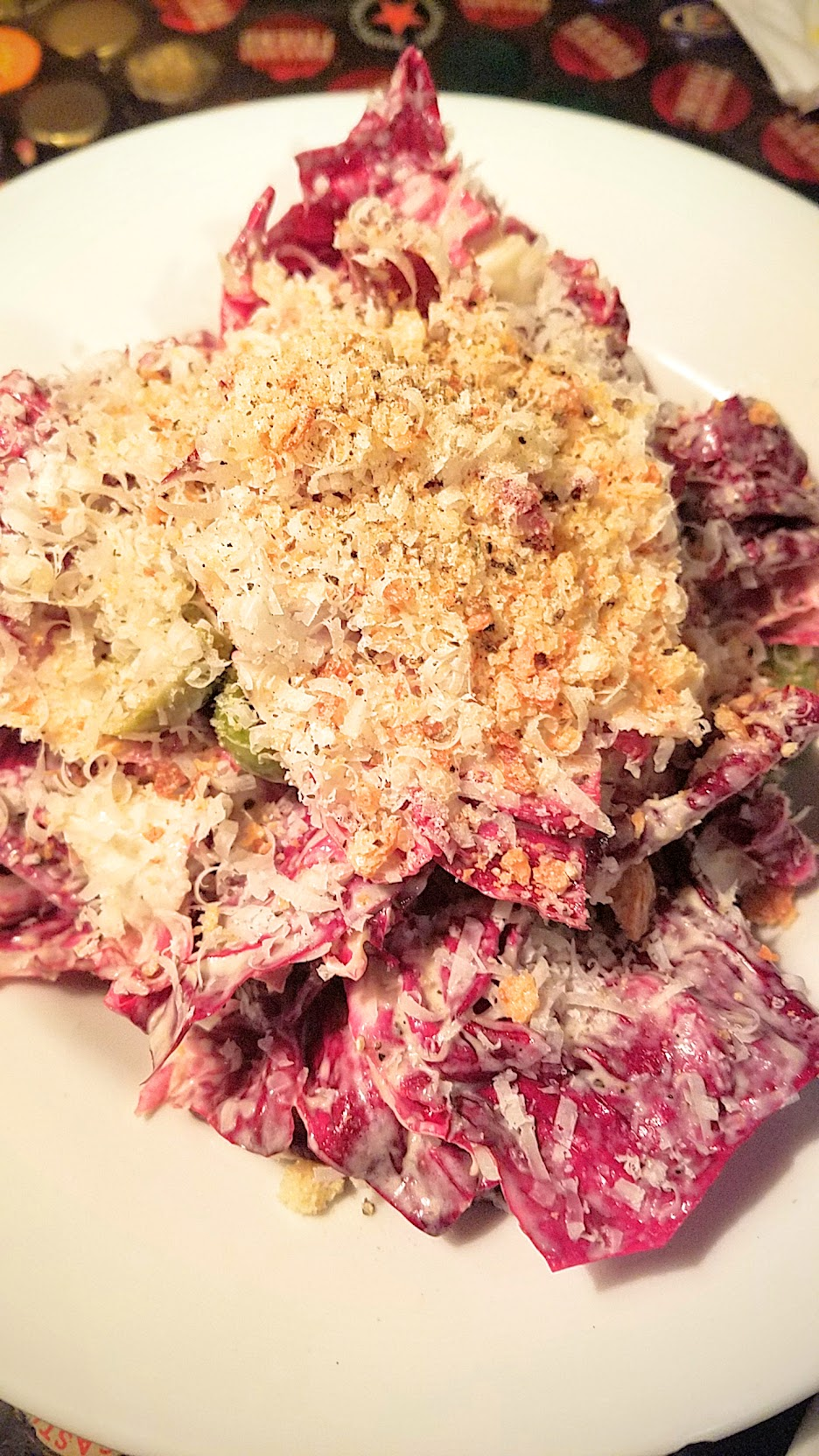 Example Food at Saraveza Radicchio salad with sherry dressing, Parmesan, olive, and breadcrumb