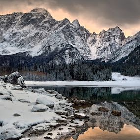 By the lake by Aleš Komovec - Landscapes Mountains & Hills ( clouds, mangart, reflection, winter, slovenia, snow, lake, stones, italy, belopeško jezero )