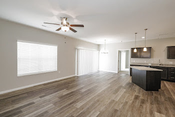 Bailey Grand floorplan living room with wood-inspired flooring and ceiling fan