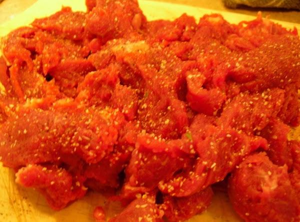 Season meat with salt, pepper, and garlic salt, to taste.