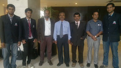 Photo: Organisers and Volunteers with Dr.Manjunath