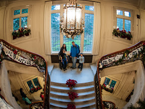 Photo: Pittock at Christmas  If you've never seen Pittock Mansion in Portland I highly recommend seeing it during the Christmas Season. The decorate the place to the hilt and it is beautiful. Even the bathrooms get Christmas Trees. Yesterday some Googlies met up at the mansion to have a little fun. We didn't hang there for too long but long enough to get a few shots of the place. Here is the grand stairway adorned by the wonderful family of +Jake Johnsonwho trekked down from Seattle for the day despite the crappy weather.