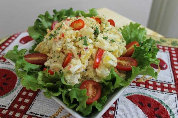 Serve salad in a bed of lettuce and garnish with sliced cherry tomatoes and...