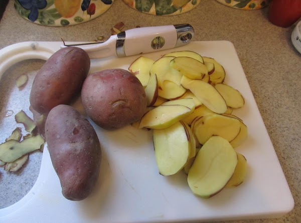 clean and removed any bad places in the red potatoes and slice thin with...