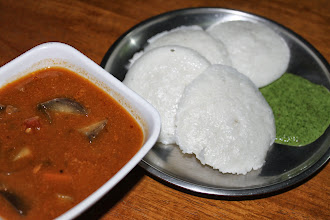 Photo: Idli (http://en.wikipedia.org/wiki/Idli) is a South Indian steam bread made of rice and black lentil batter fermented for about a half day. Yummy yet healthy, easily digestive snack that is often eaten for breakfast in Maharashtra too. Particularly Pudina chutney (green paste made of mint [Pudina], coriander, garlic, pinch of grated coconut, etc.) and Sambar soup (http://en.wikipedia.org/wiki/Sambar_(dish)) make the golden combination with Idli, because all taste sour and gentle to stomach. We like to use MTR Sambar powder (http://www.amazon.com/MTR-Sambar-Powder-200g/dp/B000JSSNFW) and bring premixed Idli batter from the nearby store, so what we need to do is keeping the batter for a half day, and cutting and adding your favourite vegetables and boiled water to the MTR masala while steaming Idli and mixing the chutney! Recently, the Times of India covered that Idli is considered the healthiest breakfast option by many Indian people (Reference: http://m.timesofindia.com/india/Idli-sambhar-most-nutritious-breakfast/articleshow/22129608.cms?utm_source=facebook.com&utm_medium=referral) 3rd September updated (日本語はこちら☆) - http://jp.asksiddhi.in/daily_detail.php?id=290