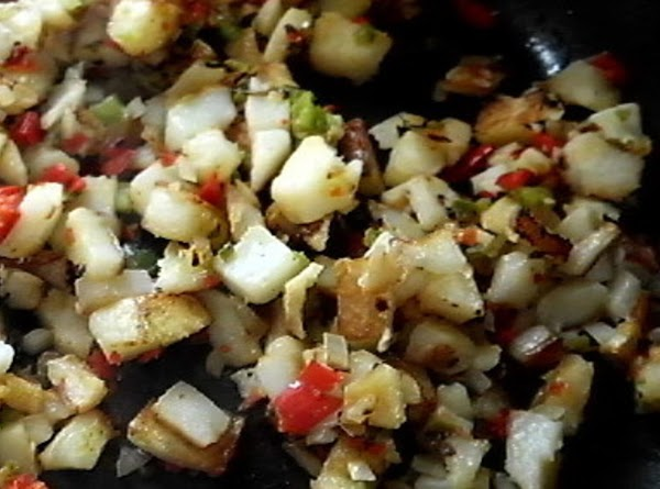 In a non-stick skillet, cook potatoes about 2 tablespoonn of olive oil for 20...
