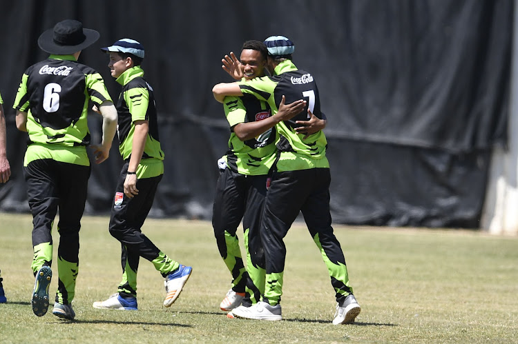 Lilitha Lubengu with teammates of St Andrews (GTown) players celebrates during day 2 of the Coca-Cola T20 Schools National Finals at Tuks Oval on March 16, 2019 in Pretoria, South Africa.