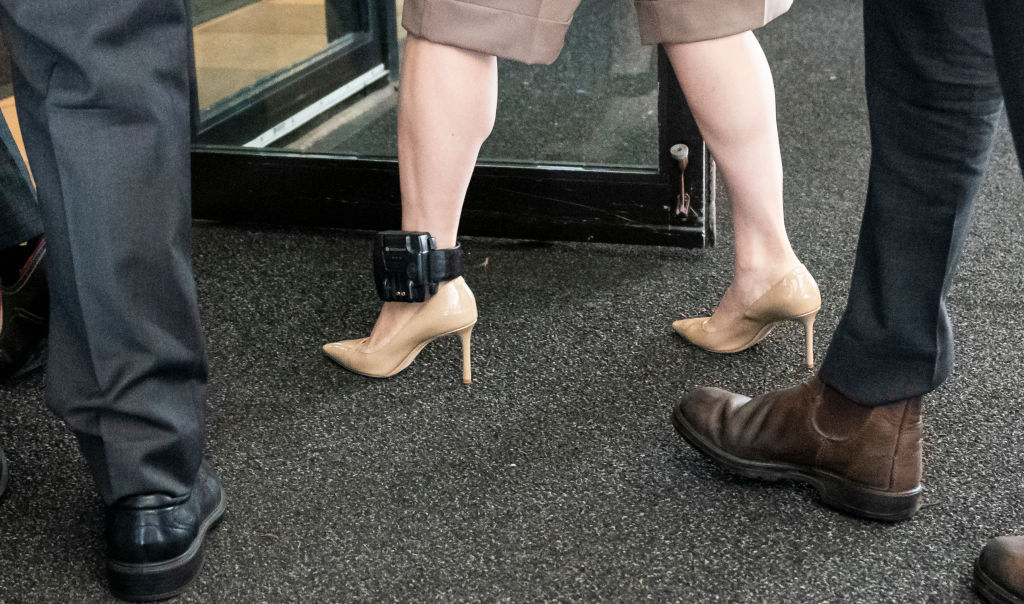 Huawei CFO Meng Wanzhou, while wearing her ankle monitoring device, walks into BC Supreme Court with her security detail to resume her fight against extradition to the United States on September 28, 2020 in Vancouver, Canada.