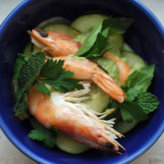 Champagne–Poached Prawns with Spicy Cucumber Salad and Green Curry–Coconut Sauce.