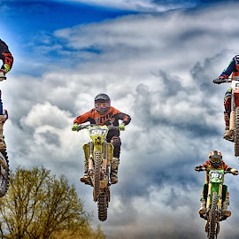 Sinusoidal by Marco Bertamé - Sports & Fitness Motorsports ( clouds, hig, speed, green, 581, number, yellow, race, jump, noise, sjky, 161, flying, red, motocross, blue, dust, 51, clumps, air, fous, grey, 72, yelloworange )