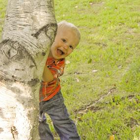 Playing peekaboo by Pamela Hammer - Babies & Children Children Candids ( child, laughing, tree, outdoors, children, peekaboo, boy )