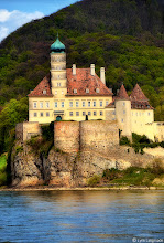 "Photo: watchman of the wachau  A shot of the Schloss Schönbühel [Schonbuhel Castle], located on the Danube amidst some of the most picturesque land in Austria, affectionately known as the Wachau [vaˈxaʊ]. Schonbuhel Castle is over 1000 years old and is called the ""Watchman of the Wachau."" The Wachau is located almost 50 miles outside of Vienna and takes approximately 1 hour by train. It's pretty easy to pick up tickets for a round-trip cruise for the 24-mile stretch of the Danube between the medieval town of Krems and Melk.  Ever since I saw Steve McQueen in the The Great Escape , I wanted to visit Austria. McQueen's notorious motorcycle escape sequence was filmed in Fussen and the Austrian Alps and was largely the reason motorcycles became so trendy in 1963. My dad actually became obsessed with motorcycles after watching McQueen race through some of the most gorgeous landscape in the world and bought one of his own.  I finally got the opportunity to visit Austria this spring. While the major focus of my trip was Vienna, there was absolutely no way I was going to leave Austria without seeing the Danube, particularly the world-renowned Wachau Valley. Picture a stretch of river enclosed on either side by towering mountains and sprinkled with Castles, ancient Ruins, Abbeys, Chapel Spires, and Vineyards and you'll begin to fathom the mythic beauty of it.  Anyway, I hope this is the first of many shots of the Wachau that I will be posting.  :)"