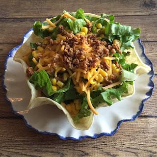 Easy Taco Salad Recipe In Taco Shell Bowls.