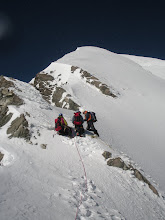 Photo: A break, a regroup, and the first close up of the summit ridge.