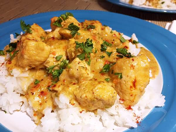 Rice With Chicken On A Blue Plate.