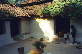 Photo: Take note of the sacred Tulsi (Basil) Plant in the middle of the house's courtyard