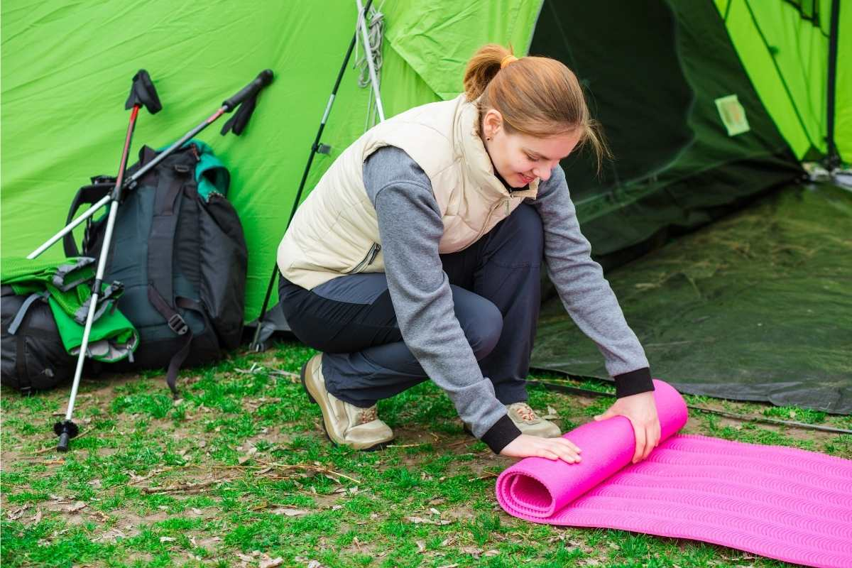how to get better  sleep while camping besides camping pillow - sleeping pad