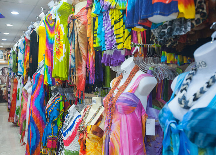 Colorful batik sundresses call out to shoppers at a tax-free boutique in Basseterre, St. Kitts.