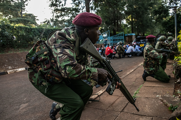 Kenyan security forces take cover after hearing gunfire coming from the Dusit Hotel complex after being rescued on January 15 2019 in Nairobi, Kenya. Picture: GETTY IMAGES ANDREW RENNEISEN